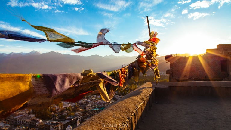 Prayer flags flying during a Himalayan Sunset in Leh city - Ladakh